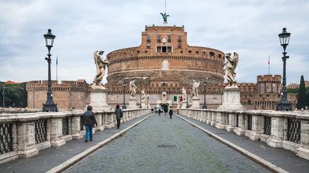 pons: ROME, ITALY - DECEMBER 17, 2010: view of Mausoleum of Hadrian (Castel Sant Angelo, Castlle of the Holy Angel) through Ponte Sant Angelo (Aelian Bridge, Pons Aelius) in Rome city in winter Editorial