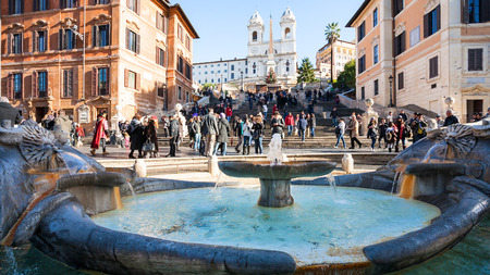 ROME, ITALY - DECEMBER 18, 2010: Old Boat Fountain on Piazza di Spagna and Spanish steps in Rome. Fountain was commissioned by Pope Urban VIII and was completed in 1627 by Pietro Bernini and his son Editorial