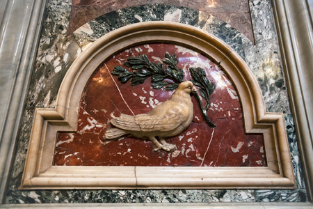 VATICAN, ITALY - DECEMBER 16, 2010: interior of St Peter Basilica , symbol of peace on wall - dove with olive branch. Basilica is Catholic Cathedral, the largest Christian church in world