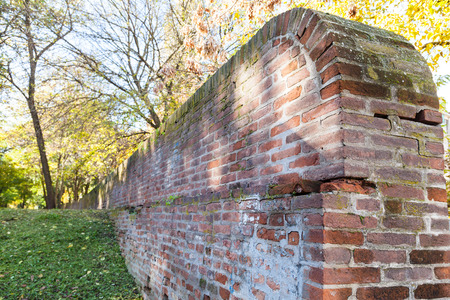 ex: travel to Italy - old brick medieval wall of the ex papal fortress in Ferrara city
