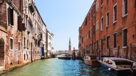 travel to Italy - Canal and bridge between shabby houses in Venice city