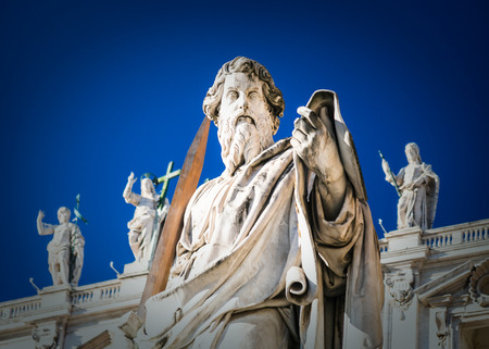 Travel to Italy - Statue of Apostle Paul near St Peter Basilica in Vatican city in sunny winter day. The statue of St Paul was sculpted in 1838 by Adamo Tadolini