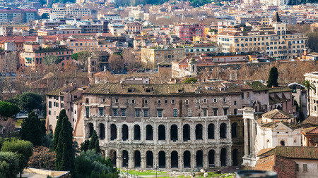 winterday: Travel to Italy - above view of Rome city with ancient Theatre of Marcellus in sunny winterday Stock Photo