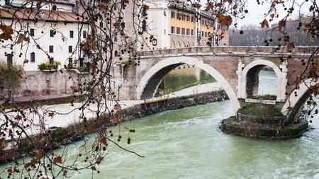 pons: Travel to Italy - view of Tiber River and Ponte Fabricio bridge (pons fabricius, ponte dei quattro capi) to Isola Tiberina (Tiber Island) in Rome city in winter