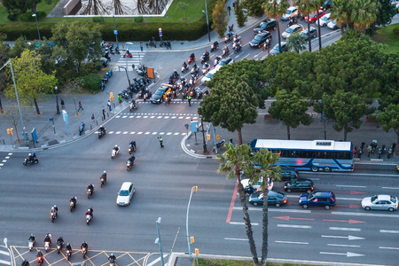 gloaming: above view of car traffic on crossroad of Avinguda Diagonal in Barcelona city in evening