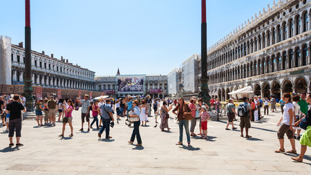 st marks square: VENICE, ITALY - JUNE 23, 2011: many tourist on St Marks Square (Piazza San Marco) in Venice city. Piazza San Marco is main public square of city.
