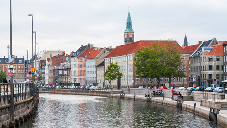 COPENHAGEN, DENMARK - SEPTEMBER10, 2011: cityscape with Frederiksholms Kanal in Copenhagen city in autumn evening twilight. Frederiksholm Canal is a canal in central city, it was dug out in 1681 Editorial