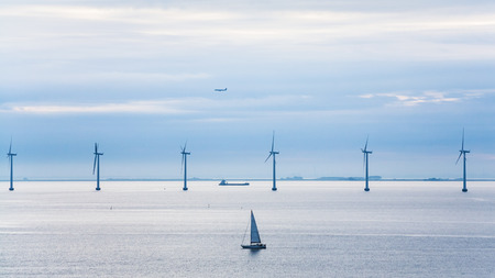 Travel to Denmark - view of yacht, ship, airplane and offshore wind farm Middelgrunden in Oresund near Copenhagen city in Baltic Sea in blue autumn morning Reklamní fotografie