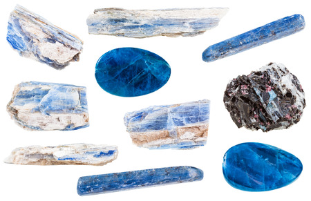 cabochon: collection of polished and raw kyanite mineral stones isolated on white background Stock Photo