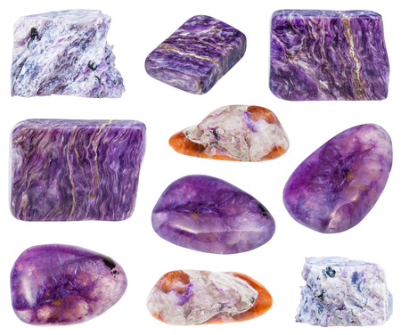 fibrous: collection of various tumbled and raw charoite mineral stones isolated on white background