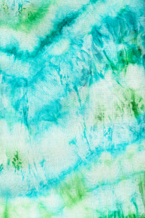 hued: textile background - abstract blue and green pattern dyed on fabric in nodular batik technique close up Stock Photo