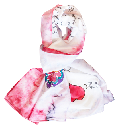 tied silk scarf hand painted in cold batik technique with red heart isolated on white background