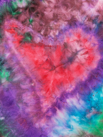 hued: textile background - styled red heart hand painted on silk batik in nodular technique