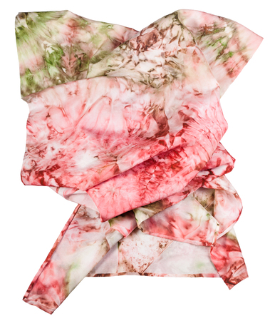 hued: wrinkled silk scarf with abstract pink and green ornament hand painted in nodular technique isolated on white background