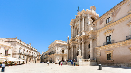 SYRACUSE, ITALY - JULY 3, 2011: tourists near Cathedral on piazza Duomo in Syracuse city in Sicily. The city is a historic town in Sicily, the capital of the province of Syracuse. Editorial
