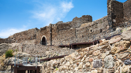 CALATABIANO, ITALY - JULY 5, 2011: people near ancient arabic - norman - byzantine castle in Sicily. Calatabiano Castle was founded by the Arabs, who moved from Calatabiano to conquer Taormina in 902