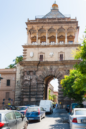 PALERMO, ITALY - JUNE, 24, 2011: view of Porta Nuova from via Corso Calatafimi in Palermo city. Porta Nuova is magnificent gateway built in 1535 in honor of Emperor Charles V victory at Tunis