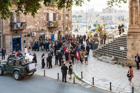 catena: PALERMO, ITALY - JUNE 24, 2011: visitors on wedding ceremony near the church Santa Maria della Catena in Palermo city. The church was built in 1490-1520, designed by Matteo Carnilivari