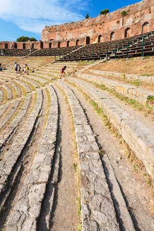 TAORMINA, ITALY - JULY 2, 2011: stone seats in ancient Teatro Greco (Greek Theatre) in Taormina city in Sicily. Arena was built in the third century BC. Editorial