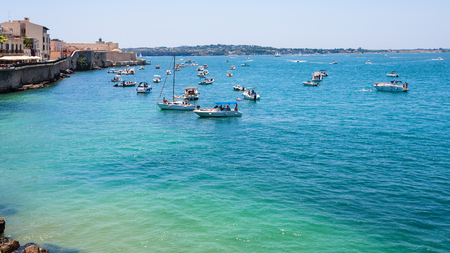Italy - boats in sea near promenade foro italico in syracuse city in Sicily