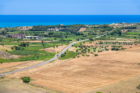 region sicilian: Italy - agrarian fields and village near Agrigento town on coast of Mediterranean sea in Sicily Stock Photo