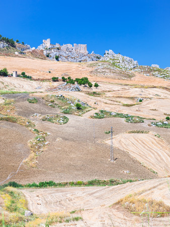 region sicilian: Italy - agrarian fields and ruins in southern Sicily in summer day