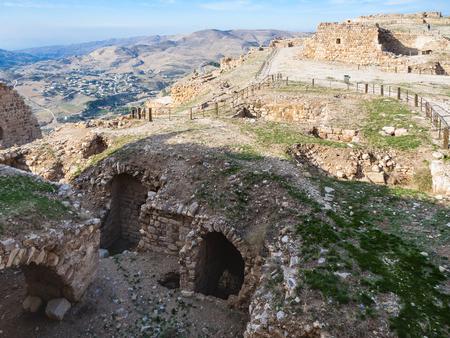 AL-KARAK, JORDAN - FEBRUARY 20, 2012: ruined rooms on upper court of medieval Kerak castle. Kerak Castle is one of the largest crusader castles in the Levant, it constructione began in the 1140s