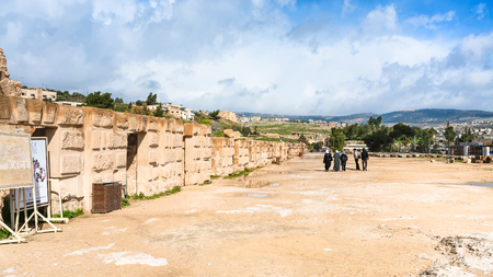 JERASH, JORDAN - FEBRUARY 18, 2012: tourists near wall of circus hippodrome in Gerasa. Greco-Roman town Gerasa (Antioch on the Golden River) was founded by Alexander the Great or his general Perdiccas