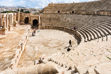JERASH, JORDAN - FEBRUARY 18, 2012: tourists in Large South Theatre in winter. Greco-Roman town Gerasa (Antioch on the Golden River) was founded by Alexander the Great or his general Perdiccas Editorial