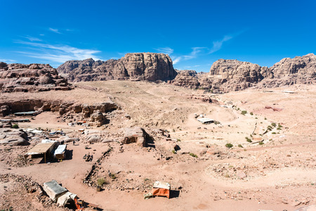 Travel to Middle East country Kingdom of Jordan - above view of bedouin camp in ancient Petra town in winter Stock Photo