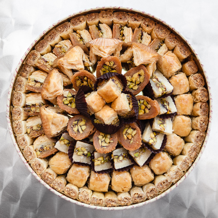 Travel to Middle East country Kingdom of Jordan - many traditional arabian sweet pastry baklava on plate