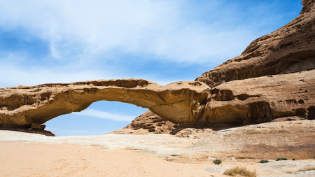Travel to Middle East country Kingdom of Jordan - view of bridge sandstone mount in Wadi Rum desert in sunny winter day