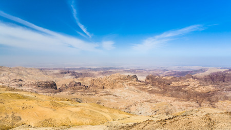 arava: Travel to Middle East country Kingdom of Jordan - blue sky over sedimentary rocks around Wadi Araba (Arabah, Arava, Aravah) area near Petra town in sunny winter day Stock Photo
