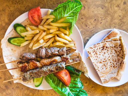 Travel to Middle East country Kingdom of Jordan - portion of various arabian kebabs in restaurant in Petra town