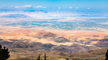 Travel to Middle East country Kingdom of Jordan - above view of hills in Holy Land from Mount Nebo in winter Stock Photo