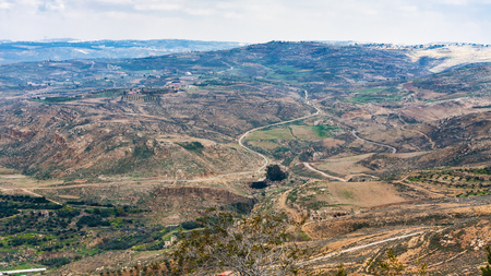 Travel to Middle East country Kingdom of Jordan - above view of rural landscape of Promised Land from Mount Nebo in winter