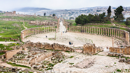 colonnade: Travel to Middle East country Kingdom of Jordan - above view of The Oval Forum and Cardo Maximus path in Jerash (ancient Gerasa) town in winter