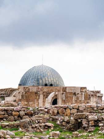 Travel to Middle East country Kingdom of Jordan - ancient Umayyad Palace at Amman Citadel in rainy day in winter