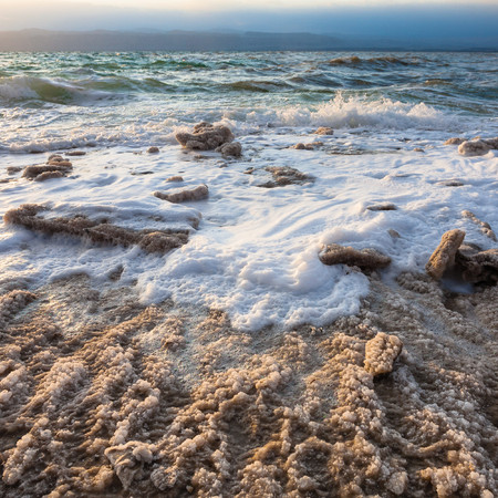 gloaming: Travel to Middle East country Kingdom of Jordan - crystalline coast of Dead Sea on winter evening Stock Photo