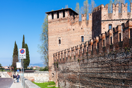 VERONA, ITALY - MARCH 27, 2017: people near Castelvecchio (Scaliger) Castle in Verona city in spring. Construction of the Caste was carried out between 1354 and 1376.