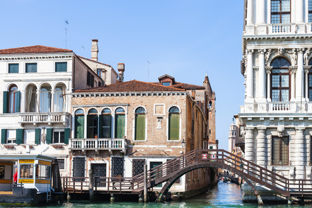waterbus: VENICE, ITALY - MARCH 30, 2017: canal near waterbus stop near palazzo Ca Rezzonico on Grand Canal in Venice. The palace is a public museum dedicated to 18th-century Venice