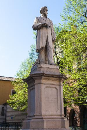 VERONA, ITALY - MARCH 29, 2017: Monument of poet, politician and patriot of the italian Risorgimento Aleardo Aleardi in Verona city in spring. The statue was inaugurated in 1883 by Ugo Zannoni