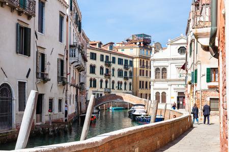 VENICE, ITALY - MARCH 30, 2017: people walk to Scuola Dalmata dei Santi Giorgio e Trifone (Scuola di San Giorgio degli Schiavon) on waterfront Fondamenta Furlani of canal Rio del la Pieta in Venice