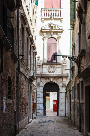 VENICE, ITALY - MARCH 30, 2017: Entrance to Museo di Palazzo Grimani on narrow street Ramo Grimani in Castello district in Venice city. The Palace became State Museums in Venice from 2001 Editorial