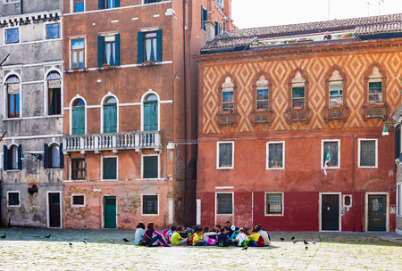 reside: VENICE, ITALY - MARCH 30, 2017: schoolchild on square Campo Santa Maria Formosa in Venice. The city has about 50,000 tourists a day and only around 55,000 people reside in the historic town Editorial