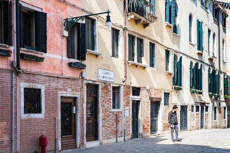 reside: VENICE, ITALY - MARCH 30, 2017: people on Campo San Silvestro in Venice city in spring. The city has about 50000 tourists a day and only around 55000 people reside in the historic town