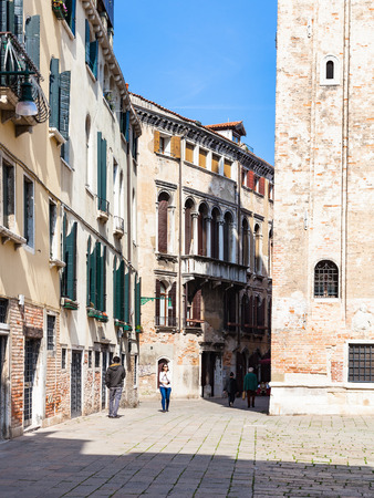 VENICE, ITALY - MARCH 30, 2017: people on street Calle Sbianchesini at Campo San Silvestro in Venice. The city has about 50000 tourists a day and only around 55000 people reside in the historic town