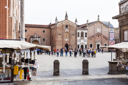 PADUA, ITALY - APRIL 1, 2017: tourists on piazza Del Santo near Basilica of Saint Anthony in Padua city in spring. The church began to be built in 1232, just one year after the death of St Anthony