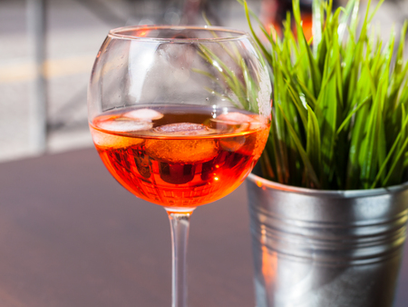 travel to Italy - glass of Spritz drink with ice on table in restaurant in Padua city in spring Stock Photo
