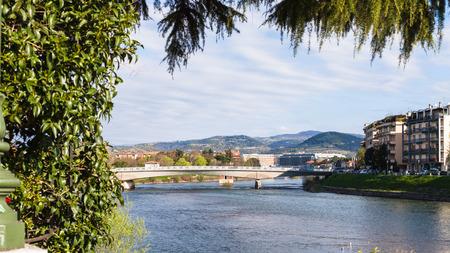 travel to Italy - view of Ponte Risorgimento of Adige river in Verona city in spring